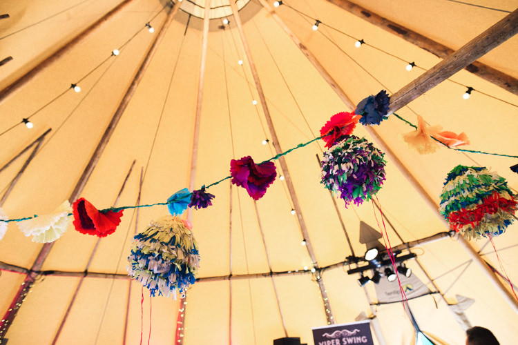 Pom Pom Festoon Lights Outdoorsy Welcoming Colourful Tipi Wedding http://www.sallytphoto.com/