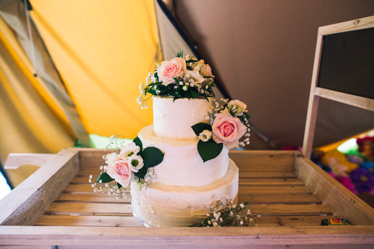 Buttercream Cake Flowers Outdoorsy Welcoming Colourful Tipi Wedding http://www.sallytphoto.com/