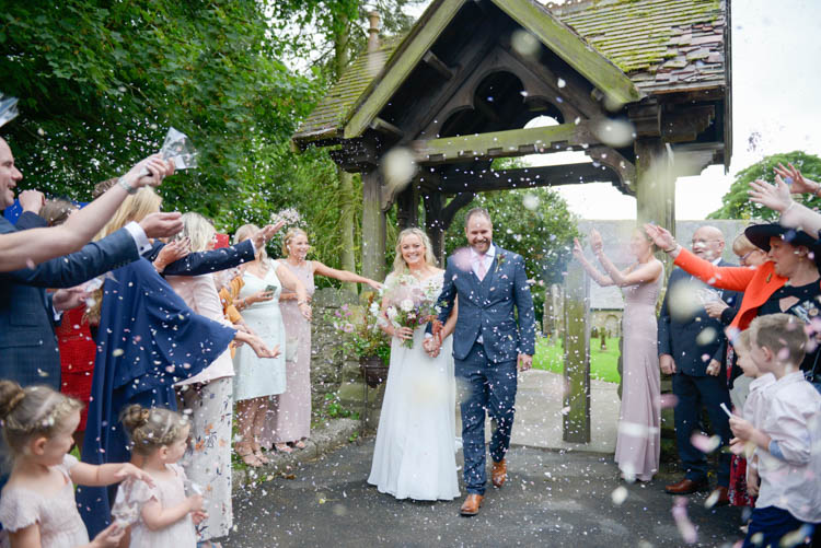 Bride Bridal Justin Alexander Dress Gown A Line Slaters Menswear Groom Grey Checked Three Piece Waistcoat Suit Pocket Square Watch Pink Tie Confetti Shot Moment Church Lychgate Fun Pastel Country Marquee Wedding http://kimberleywaterson.com/