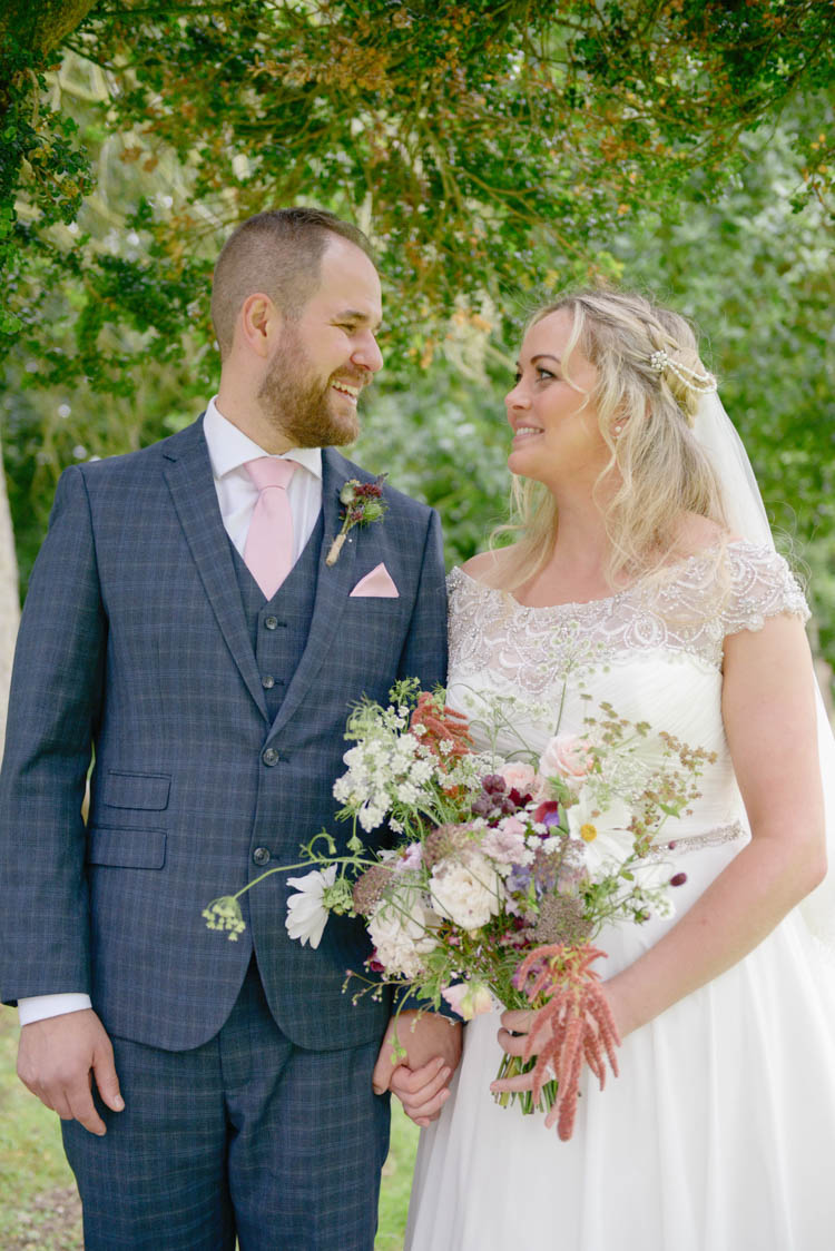 Bride Bridal Justin Alexander Dress Gown A Line Slaters Menswear Groom Grey Checked Three Piece Waistcoat Suit Pocket Square Watch Pink Tie Bouquet Meadow Wild Flower Florals Fun Pastel Country Marquee Wedding http://kimberleywaterson.com/
