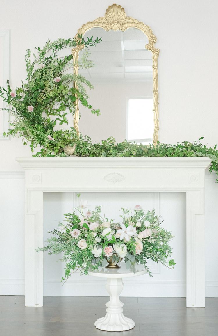 Fireplace Mantle Flowers Greenery Foliage Pink Light Soft Romantic Wedding Ideas http://www.vanessavelez.photo/