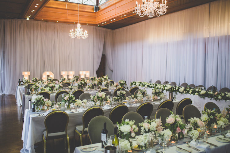 Draping Chandelier White Pink Blush Pale Floral Flowers Grey Voile Table Setting Black Tie Glamour Country Estate Wedding https://www.chrisblackledgephotography.co.uk/