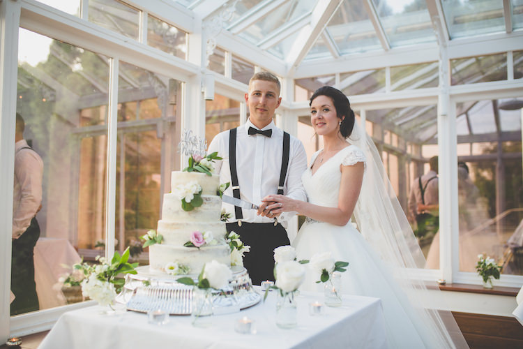Semi-Naked Cake Buttercream Mr & Mrs Cut Out Topper Glitter Cutting Bride Bridal Ronald Joyce A Line Dress Long Veil Cap Sleeve Groom Braces Bow Tie Black Tie Glamour Country Estate Wedding https://www.chrisblackledgephotography.co.uk/