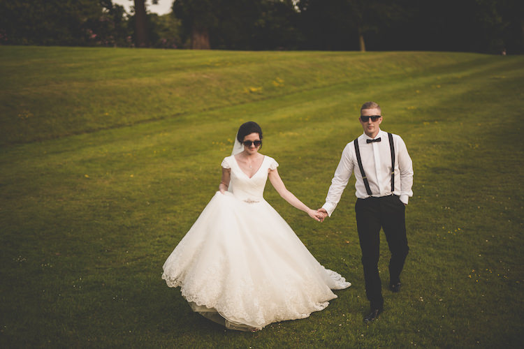 Bride Bridal A Line Ronald Joyce Dress V Neck Cap Sleeve Groom Braces Bow Tie Sunglasses Black Tie Glamour Country Estate Wedding https://www.chrisblackledgephotography.co.uk/