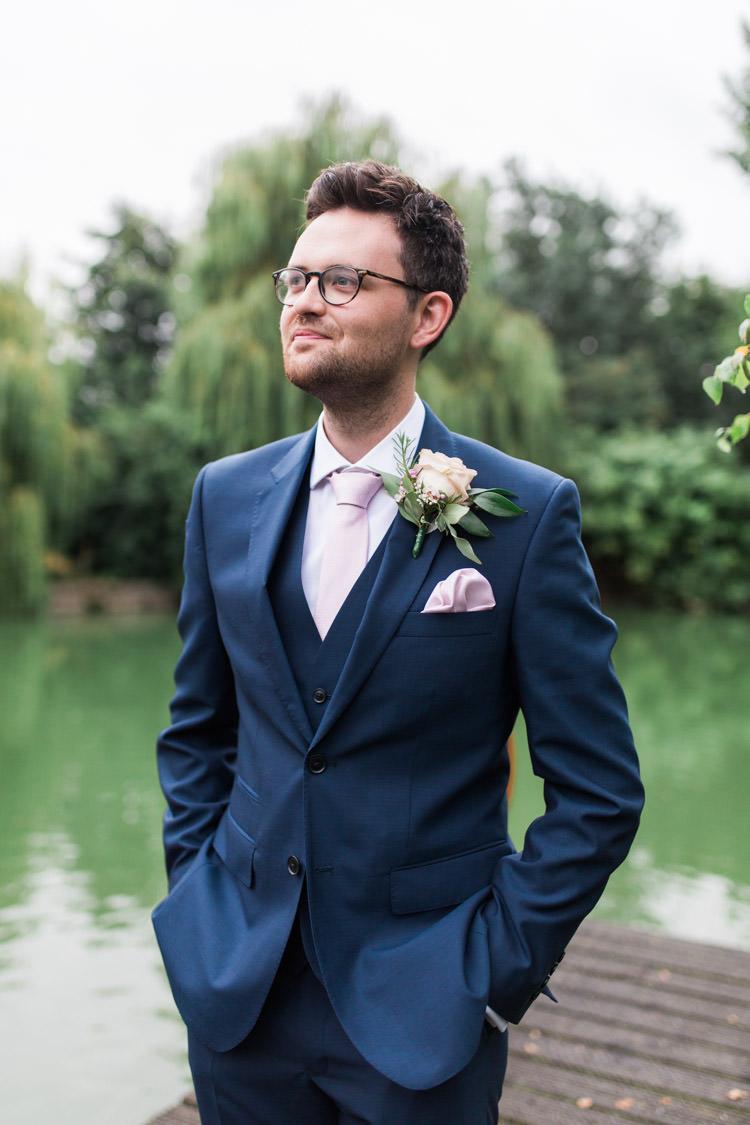 Groom Suit Navy Pink Tie Glasses Simple Natural Honest Marquee Wedding https://www.gemmagiorgio.com/