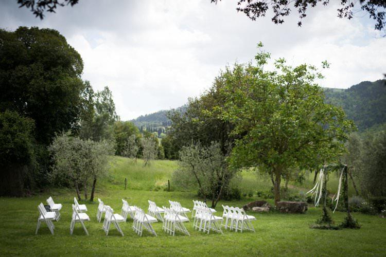 Ceremony White Chairs Sunflower Arch Ribbons Yellow Navy Outdoor Tuscany Wedding http://www.natalymontanari.com/