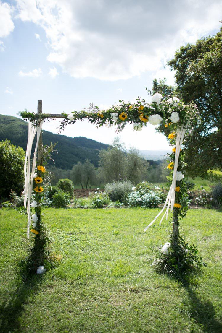 Ceremony Archway Ribbons Sunflowers Yellow Navy Outdoor Tuscany Wedding http://www.natalymontanari.com/