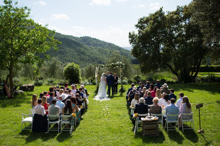 Ceremony Aisle Guests Yellow Navy Outdoor Tuscany Wedding http://www.natalymontanari.com/