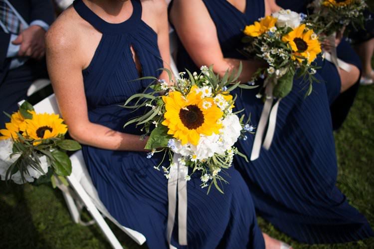 Bridesmaids Halter Neck Dress Sunflowers Daisies Yellow Navy Outdoor Tuscany Wedding http://www.natalymontanari.com/