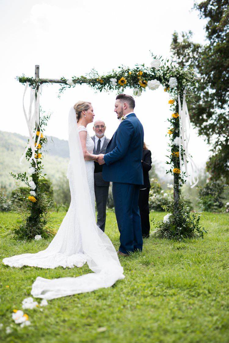 Ceremony Sunflower Arch Bride Long Veil Yellow Navy Outdoor Tuscany Wedding http://www.natalymontanari.com/