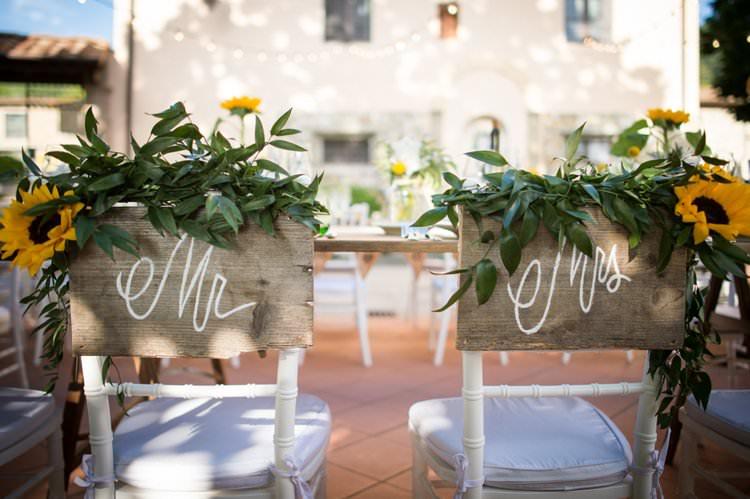 Mr Mrs Chair Backs Sunflowers Yellow Navy Outdoor Tuscany Wedding http://www.natalymontanari.com/