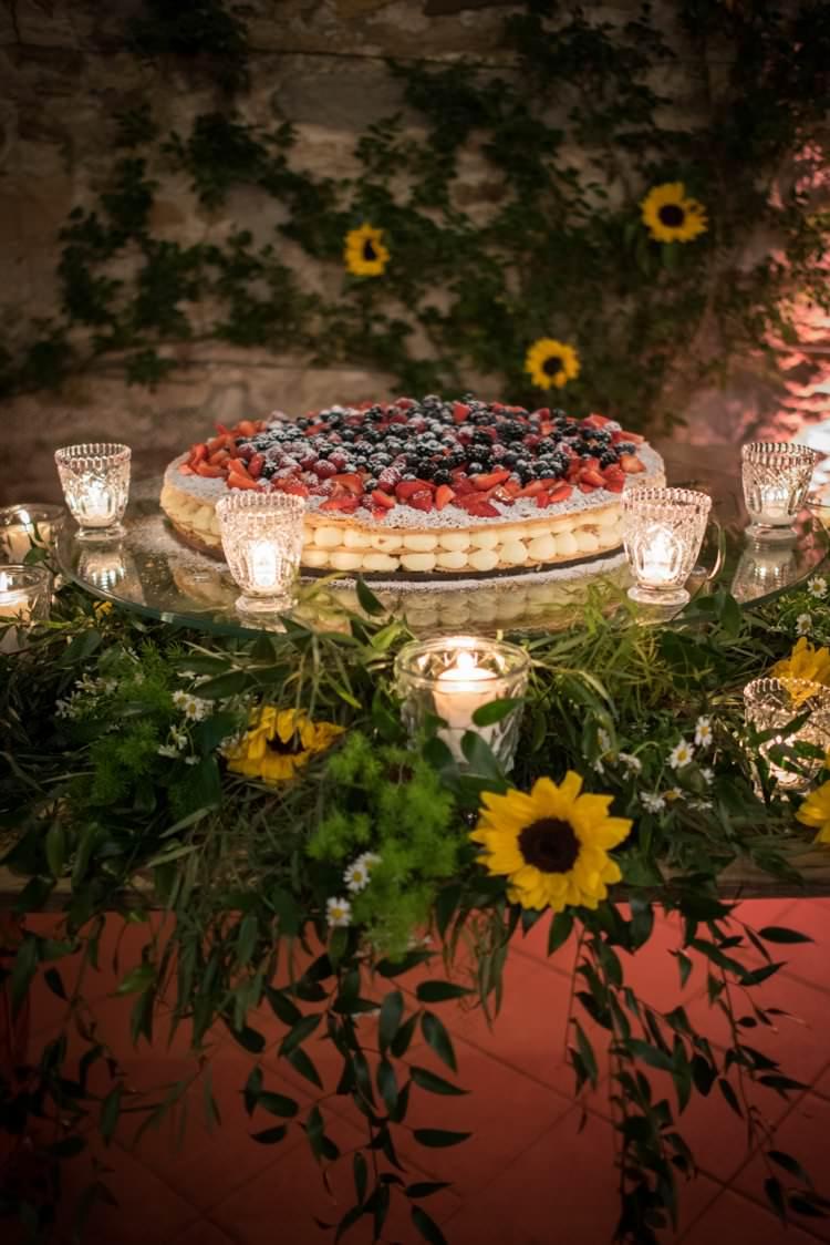 Italian Cake Cream Berries Sunflowers Candles Yellow Navy Outdoor Tuscany Wedding http://www.natalymontanari.com/