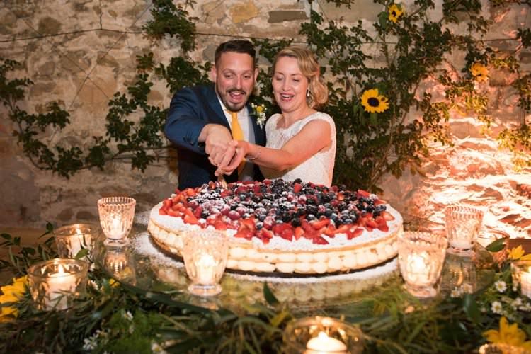 Italian Cake Cutting Cream Berries Sunflowers Candles Yellow Navy Outdoor Tuscany Wedding http://www.natalymontanari.com/