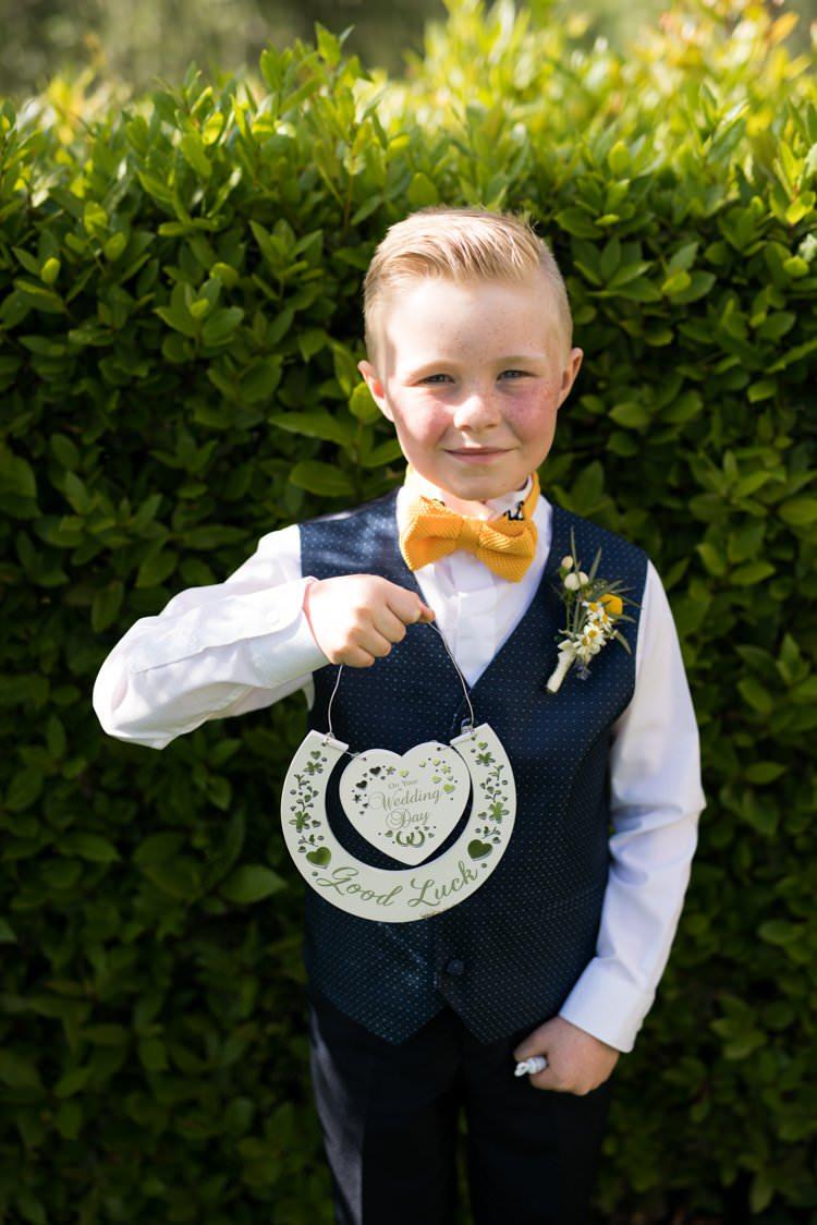 Page Boy Knitted Bow Tie Polka Dot Waistcoat Horseshoe Buttonhole Daisies Yellow Navy Outdoor Tuscany Wedding http://www.natalymontanari.com/