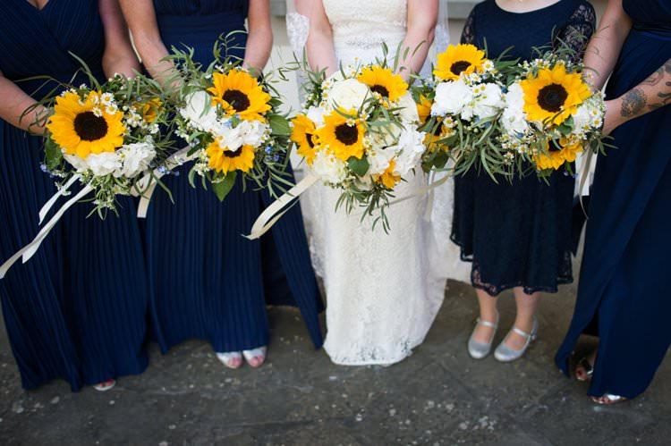 Bouquets Sunflowers Roses Daisies Bridesmaids Yellow Navy Outdoor Tuscany Wedding http://www.natalymontanari.com/