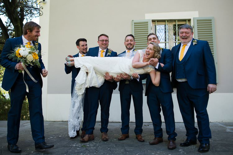 Bride Lift Groomsmen Yellow Navy Outdoor Tuscany Wedding http://www.natalymontanari.com/