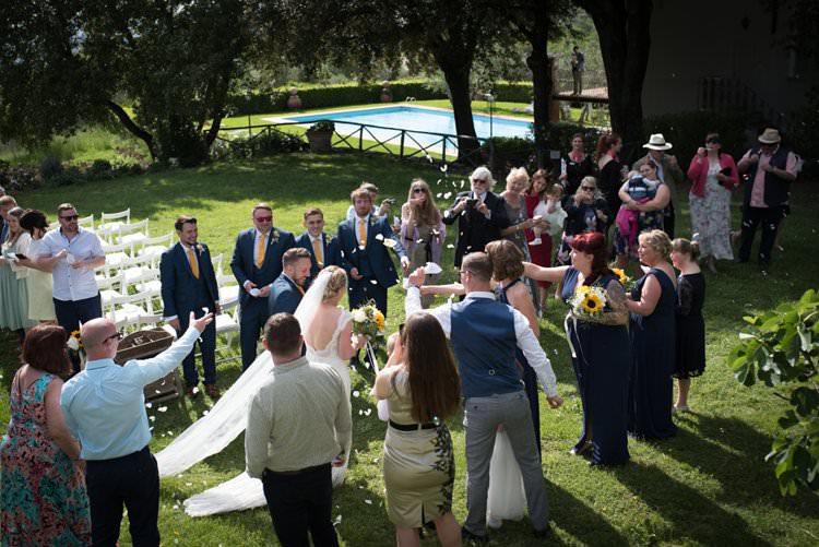 Recessional Confetti Toss Yellow Navy Outdoor Tuscany Wedding http://www.natalymontanari.com/