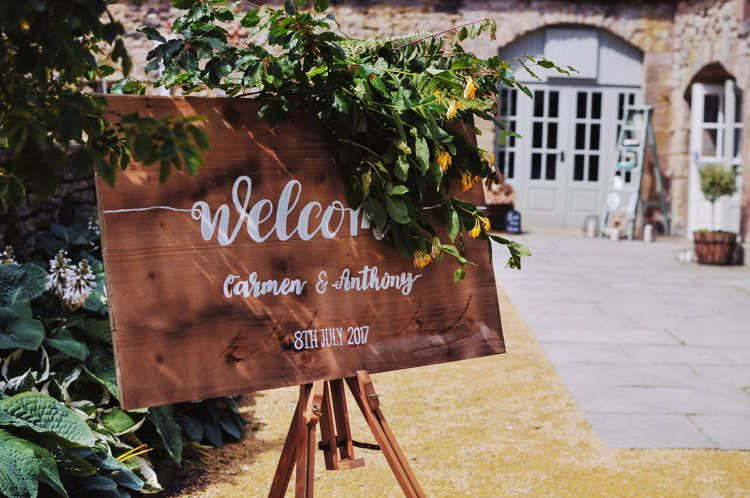 Wooden Welcome Sign Calligraphy Foliage Flowers Bohemian Creative Summer Barn Wedding http://www.pocketsquarephotography.com/