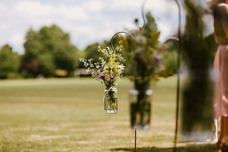 Meadow Wildflower Shepherds Crook Jar Aisle Florals Multicoloured Hand Made Fun Outdoor Wedding https://www.sharrongibson.co.uk/