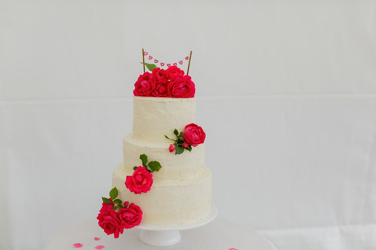 Cake Tiered Buttercream Flowers Floral Rose Bunting Topper Stand Multicoloured Hand Made Fun Outdoor Wedding https://www.sharrongibson.co.uk/