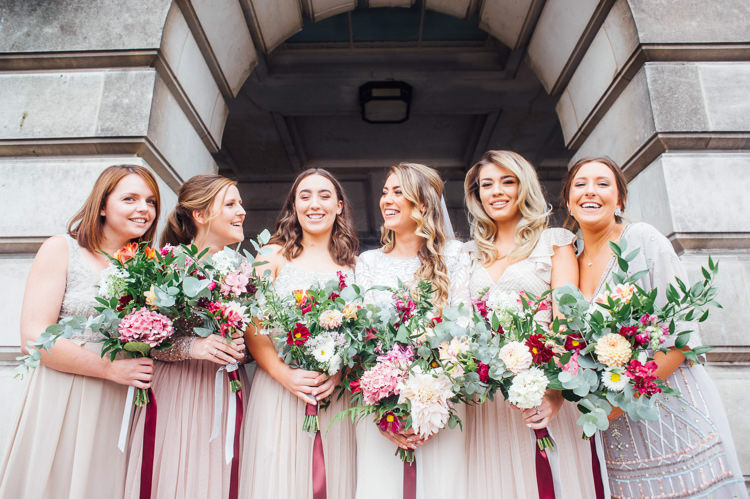 Mismatched Bridesmaids Dresses Bouquets Flowers Pink Greenery Ribbons Whimsical Stylish Burgundy Rose Gold Tent Wedding https://www.jakemorley.co.uk/