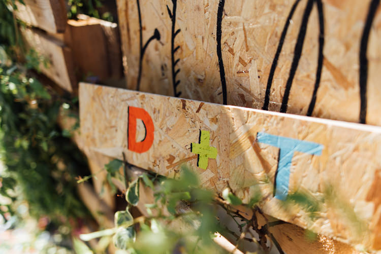 Wooden Painted Sign Alternative Colourful Outdoor Humanist Village Hall Wedding http://www.chebirchhayesphotography.com/