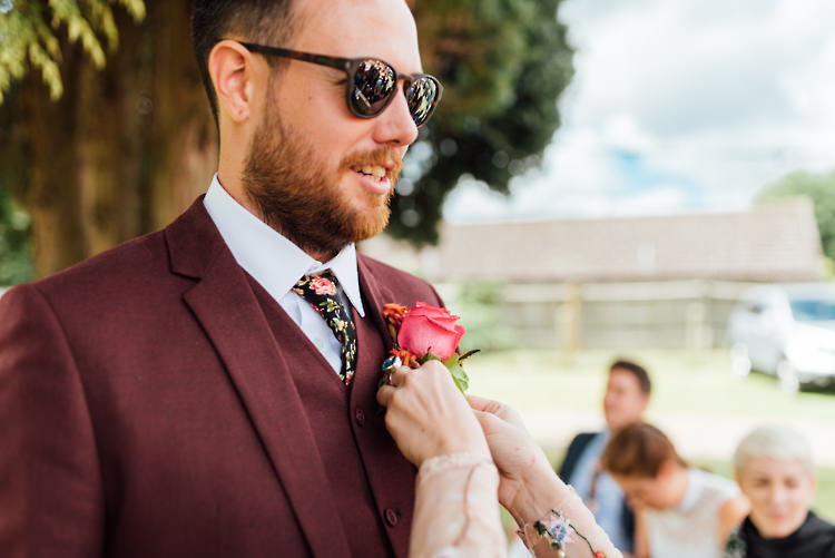 Burgundy Suit Floral Tie Sunglasses Groom Alternative Colourful Outdoor Humanist Village Hall Wedding http://www.chebirchhayesphotography.com/