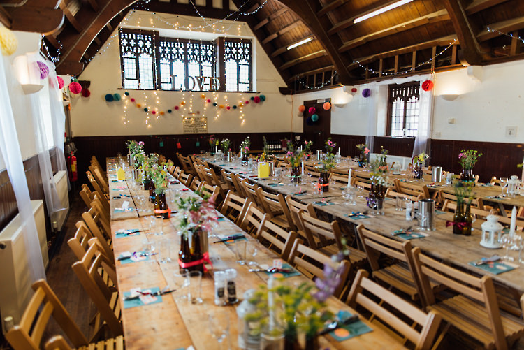 Lighting Pom Poms Long Wooden Tables Alternative Colourful Outdoor Humanist Village Hall Wedding http://www.chebirchhayesphotography.com/