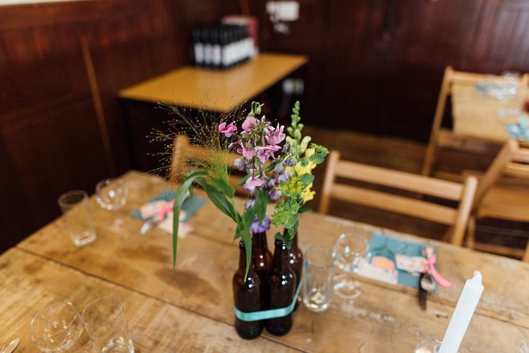 Brown Beer Bottle Flowers Centrpeice Alternative Colourful Outdoor Humanist Village Hall Wedding http://www.chebirchhayesphotography.com/