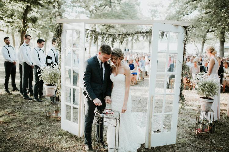 Outdoor Rustic Boho Forest Ceremony Backdrop Rug Vintage Door Window Greenery | Organic Earthy Fun Wedding Oklahoma http://zaynewilliams.com/
