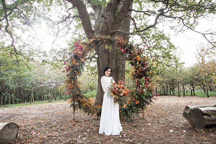 Wreath Hoop Large Backdrop Flowers Floral Orange Red 1970s Gypsy Bohemian Autumn Woodland Wedding Ideas http://carolineopacicphotography.com/