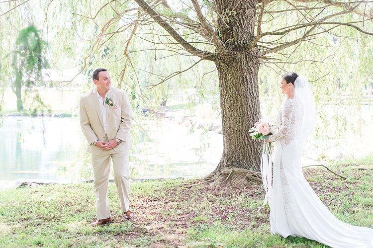 First Look Bride Groom Outdoors Tree Lake Lace Gown Cream Suit Bright Coral Garden Wedding New Jersey http://somethingbluenj.com/