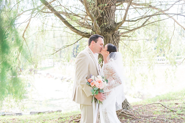 Bride Lace Gown Groom Cream Suit Pastel Bouquet Kiss Bright Coral Garden Wedding New Jersey http://somethingbluenj.com/