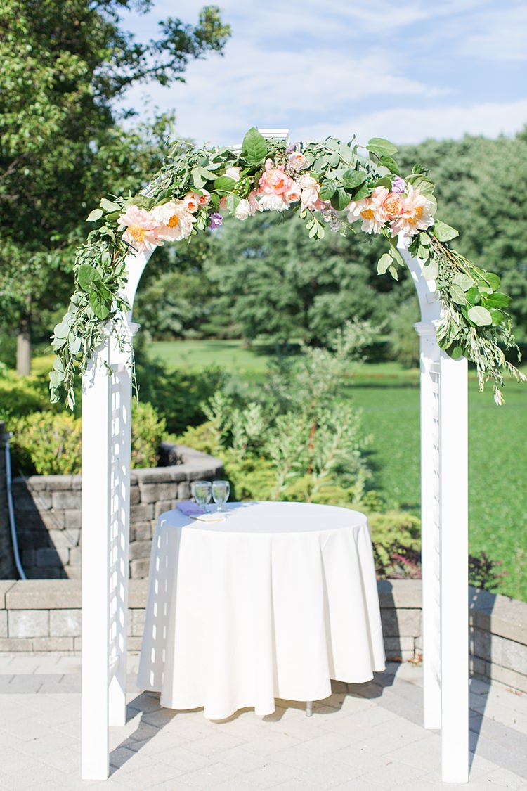 White Archway Roses Greenery Ceremony Outdoors Bright Coral Garden Wedding New Jersey http://somethingbluenj.com/