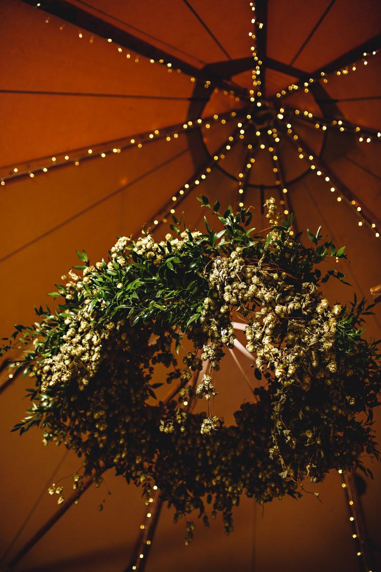 Hanging Hops Flowers Ceiling Fairy Lights Hoop Cosy Autumn Woodland Tipi Wedding Ideas http://hbaphotography.com/