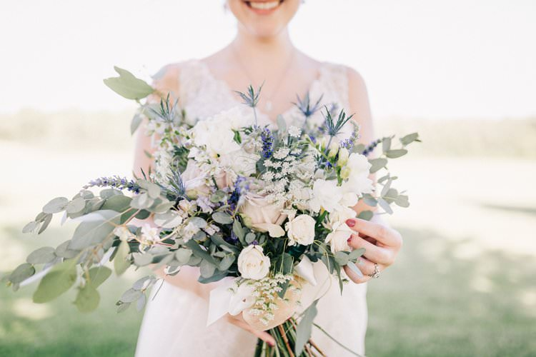 Bride Updo Lace Dress Floaty Bouquet Blush Roses Purple Thistle Outdoorsy Modern Wedding in Wisconsin http://www.mcnielphotography.com/
