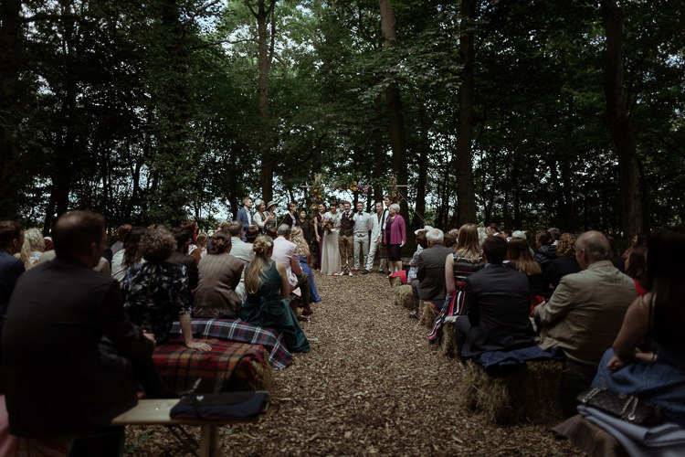 Ceremony Hay Bales Tartan Blankets Rugs Magical Woodland Clearing Colourful Tipis Wedding https://www.lukebellphotography.co.uk/