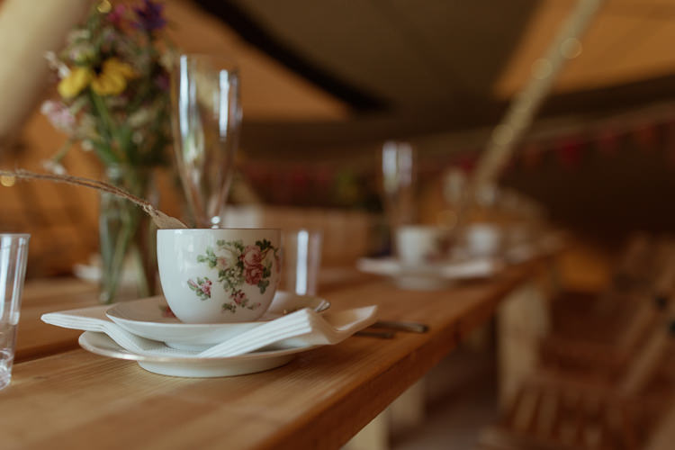 Rustic Wooden Table Vintage Crockery Tea Set Tipi Magical Woodland Clearing Colourful Tipis Wedding https://www.lukebellphotography.co.uk/