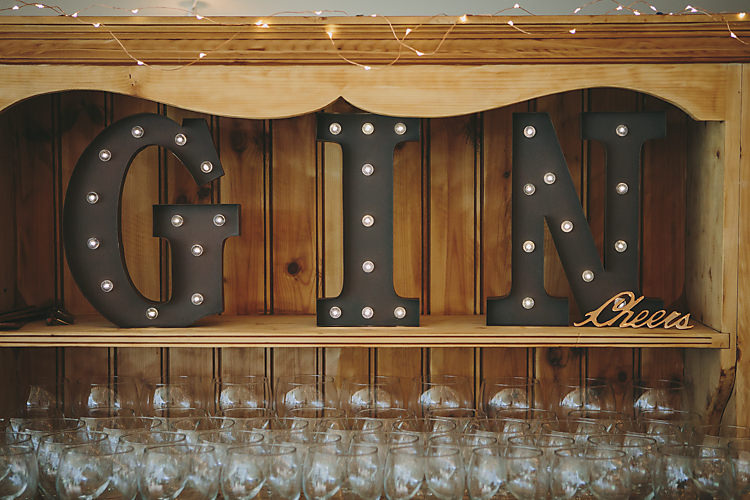 Gin Bar Balloon Glasses Circus Lights Dresser Light Up Letters Pretty Country Gin Wedding http://www.victoriasomersethowphotography.co.uk/