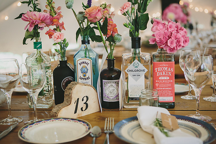 Table Centre Number Wood Slice Stencil Bottles Blooms Floral Flowers Setting Pretty Country Gin Wedding http://www.victoriasomersethowphotography.co.uk/