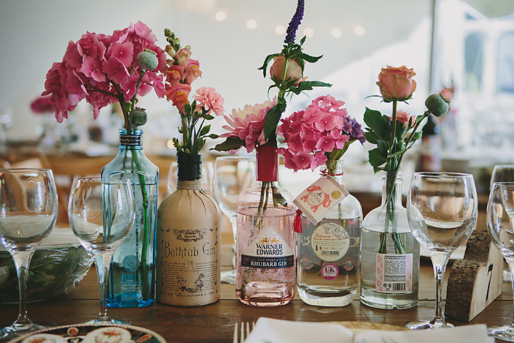 Bottle Bloom Floral Flowers Vintage Pretty Country Gin Wedding http://www.victoriasomersethowphotography.co.uk/
