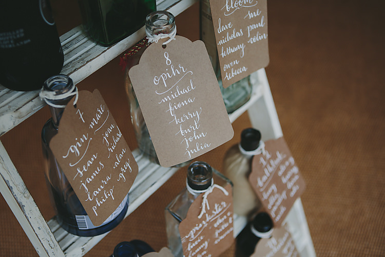 Table Plan Bottles Vintage Luggage Tag Modern Calligraphy Pretty Country Gin Wedding http://www.victoriasomersethowphotography.co.uk/