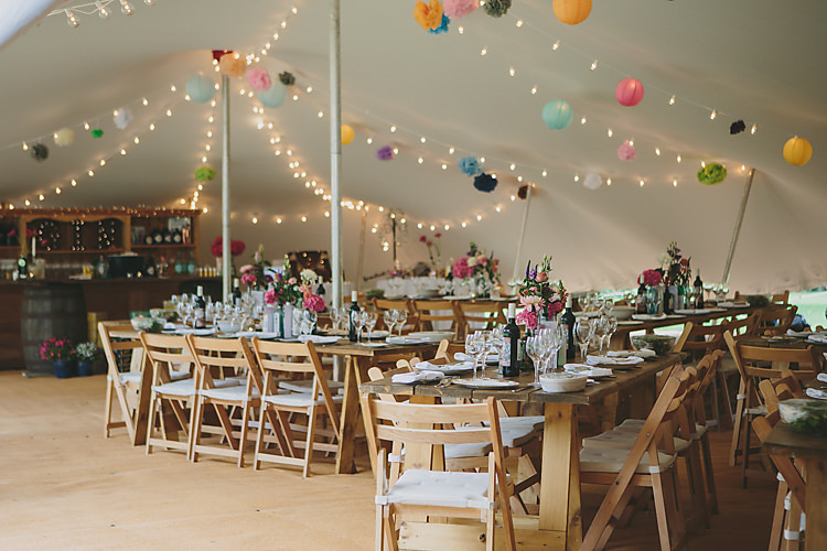 Rustic Wooden Table Chairs Stretch Tent Fairy Lights Pom Pom Lantern Paper Pretty Country Gin Wedding http://www.victoriasomersethowphotography.co.uk/