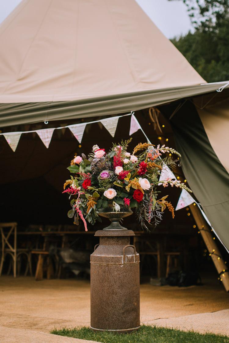 Flowers Arrangememnt Milk Church Urn Outdoor Orange Red Rose Astilbe Greenery Foliage Edgy Seasonal Autumnal Tipi Wedding Ideas http://www.sambennettphotography.co.uk/