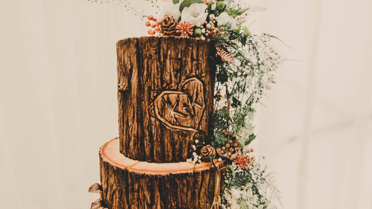 Log Wood Slice Tiered Buttercream Cake Moss Table Flowers Floral Topper Rose Gold Sequins Greenery Musical Wedding https://www.jademaguirephotography.uk/