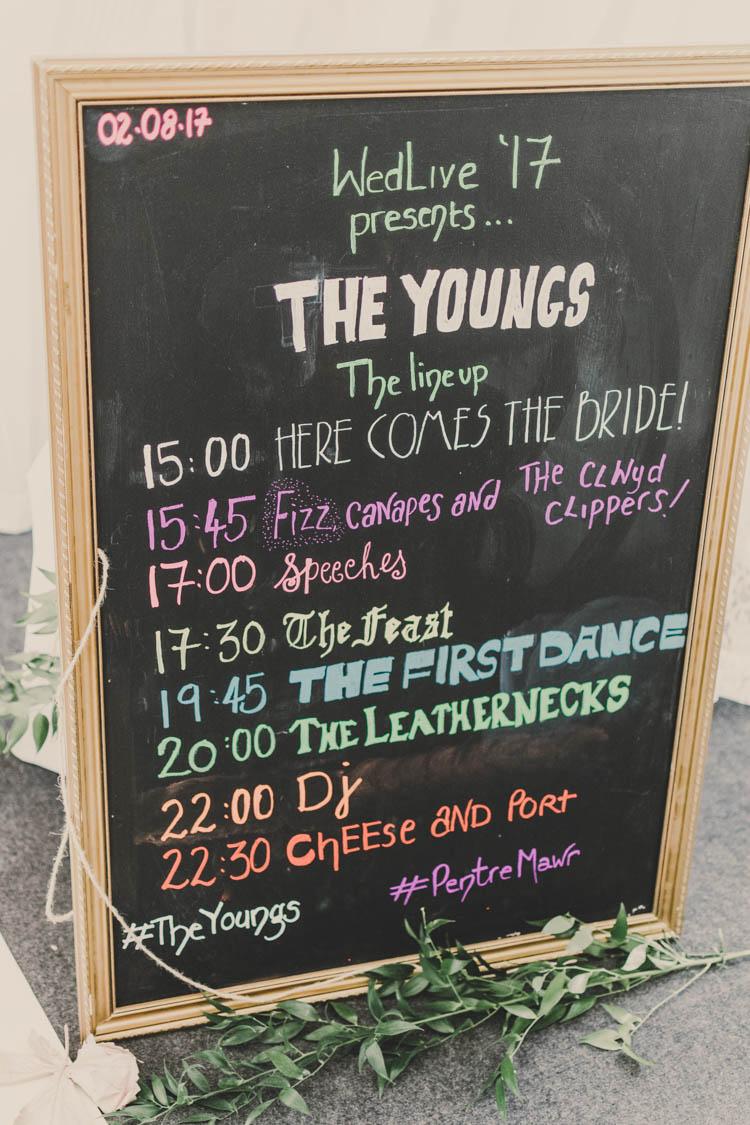 Line Up Order of the Day Blackboard Chalk Board Festival Fest Gold Frame Rose Gold Sequins Greenery Musical Wedding https://www.jademaguirephotography.uk/