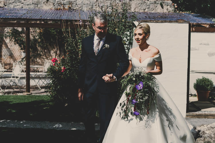 Bride Bridal Princess A Line Bardot Off the Shoulder Straps Trailing Bouquet Foliage Purple Flowers Rose Gold Sequins Greenery Musical Wedding https://www.jademaguirephotography.uk/
