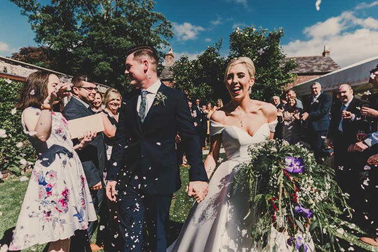 Bride Bridal Princess A Line Bardot Off the Shoulder Straps Sweetheart Neckline Ted Baker Groom Mod Suit Confetti Moment Shot Rose Gold Sequins Greenery Musical Wedding https://www.jademaguirephotography.uk/