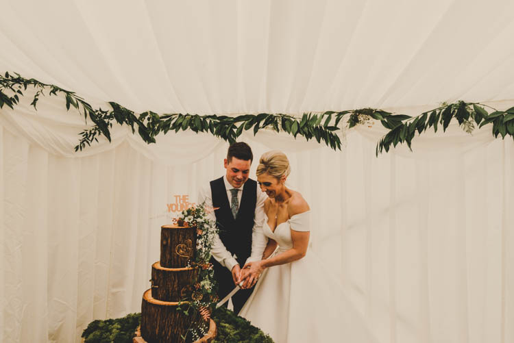Bride Bridal Princess A Line Bardot Off the Shoulder Straps Sweetheart Neckline Ted Baker Groom Mod Suit Cake Cutting Log Wood Tiered Buttercream Moss Table Rose Gold Sequins Greenery Musical Wedding https://www.jademaguirephotography.uk/
