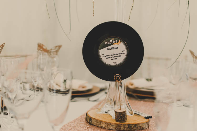 Record Table Centre Wood Slice Log Runner Rose Gold Sequins Greenery Musical Wedding https://www.jademaguirephotography.uk/